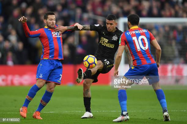 Kenedy of Newcastle United is challenged by Yohan Cabaye and Andros Townsend of Crystal Palace during the Premier League match between Crystal Palace...
