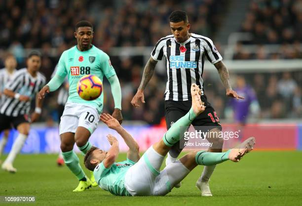 Kenedy of Newcastle United is tackled by Simon Francis of AFC Bournemouth during the Premier League match between Newcastle United and AFC...