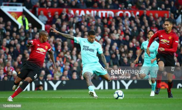 Kenedy of Newcastle United scores his team's first goal during the Premier League match between Manchester United and Newcastle United at Old...