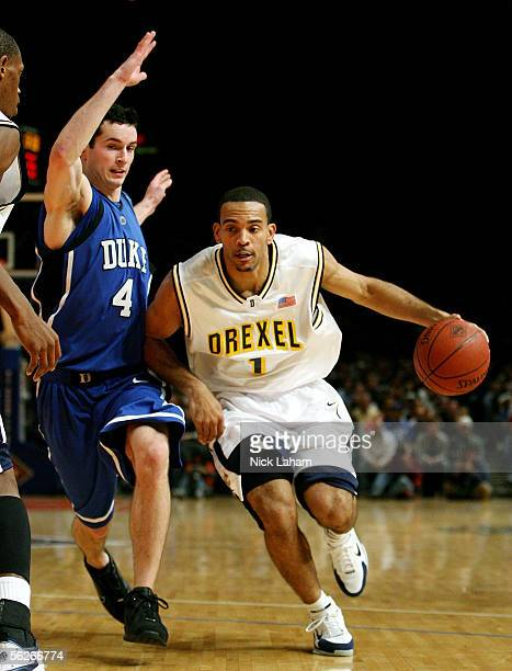 Kenell Sanchez of the Drexel Dragons drives around JJ Redick of the Duke Blue Devils during their Preseason NIT game at Madison Square Garden on...