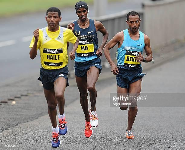 Kenenisa Bekele Haile Gebrselassie and Mo Farah race during the Great North Run on September 15 2013 in Gateshead England