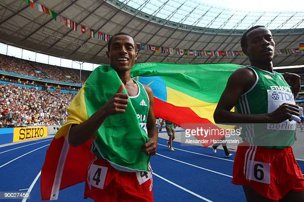 Kenenisa Bekele of Ethiopia and Ali Abdosh of Ethiopia celebrate after the men's 5000 Metres Final during day nine of the 12th IAAF World Athletics...