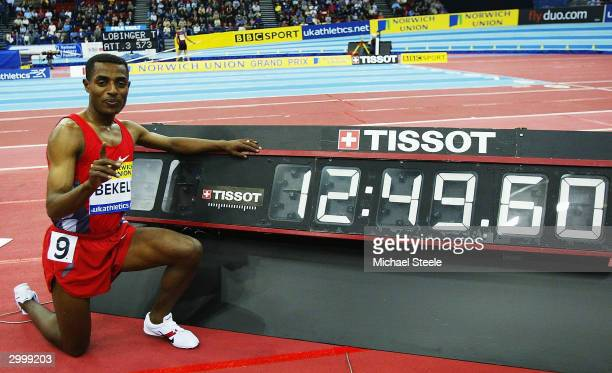 Kenenisa Bekele of Ethiopia celebrates breaking the world 5000m record during the Norwich Union Grand Prix at the Birmingham National Indoor Arena on...