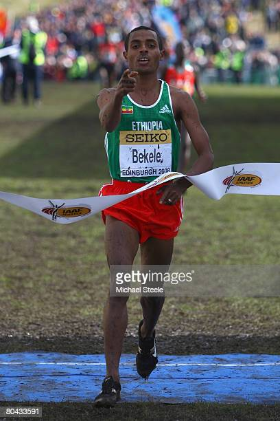 Kenenisa Bekele of Ethiopia celebrates victory and his sixth overall world cross title in the men's elite race during the 36th IAAF World Cross...