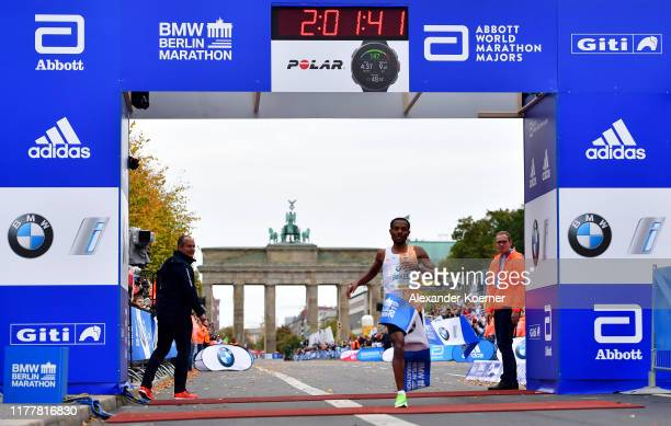 Kenenisa Bekele of Ethiopia crosses the finish line in first place to win the 46th Berlin Marathon 2019 on September 29 2019 in Berlin Germany