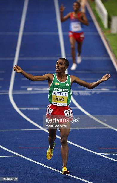 Kenenisa Bekele of Ethiopia crosses the line and celebrates winning the gold medal in the men's 10000 Metres Final during day three of the 12th IAAF...