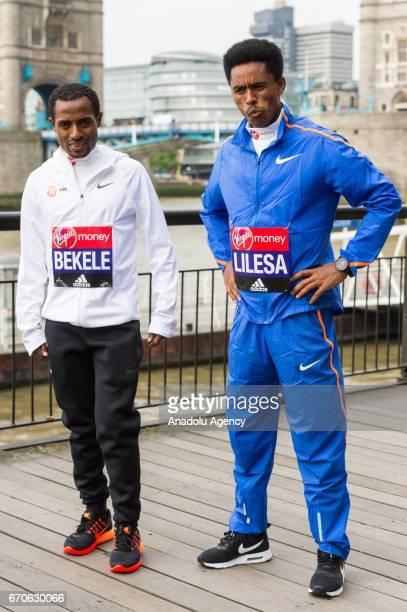 Kenenisa Bekele of Ethopia and Feyisa Lilesa of Ethopia pose during the London Marathon photo call on April 20 2017 in London United Kingdom