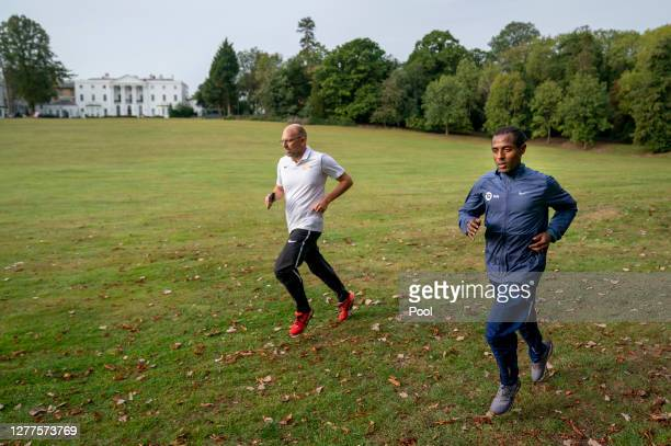 Kenenisa Bekele trains alongside his coach Peter Eemers within the grounds of the official hotel [location not disclosed] and biosecure bubble ahead...