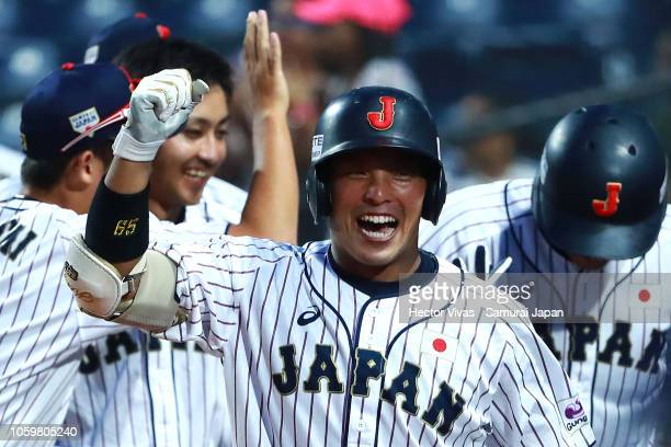 Kengo Horiuchi of Japan celebrates with teammates after scoring a home run in the 8th inning during the WBSC U23 World Cup Super Round between Japan...