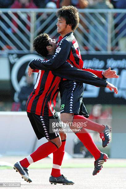 Kengo Ishii of Consadole Sapporo celebrates scoring his team's first goal with his team mate Hulk during the JLeague second division match between...