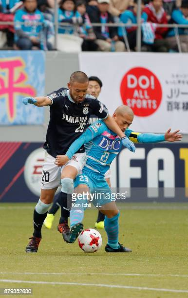 Kengo Kawamata of Jubilo Iwata and Yutaka Yoshida of Sagan Tosu compete for the ball during the JLeague J1 match between Sagan Tosu and Jubilo Iwata...