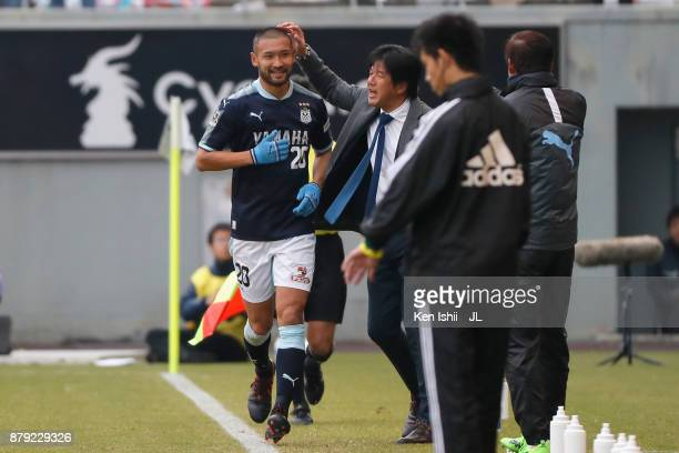 Kengo Kawamata of Jubilo Iwata is congratulated by head coach Hiroshi Nanami after scoring his side's second goal with his team mate Takuya Matsuura...