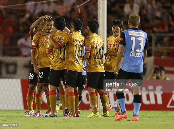 Kengo Kawamata of Nagoya Grampus celebrates scoring his team's first goal with his teammates during the JLeague match between Nagoya Grampus and...