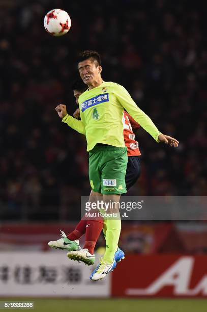 Kengo Kitazume of JEF United Chiba and Ryota Aoki of Nagoya Grampus compete for the ball during the JLeague J1 Promotion PlayOff semi final match...
