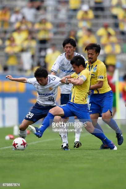 Kengo Kotani of Giravanz Kitakyushu and Ren Sengoku of Tochigi SC compete for the ball during the JLeague J3 match between Tochigi SC and Giravanz...