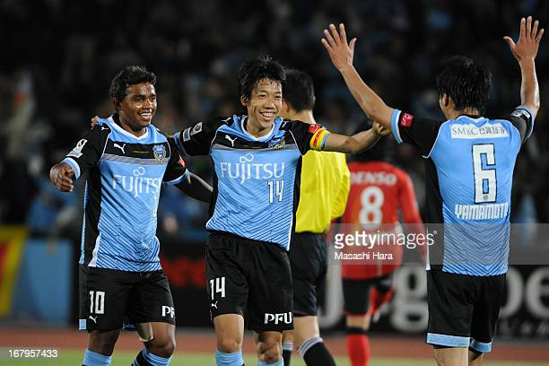 Kengo Nakamura and Renato of Kawasaki Frontale celebrate winning the JLeague match between Kawasaki Frontale and Nagoya Grampus at Todoroki Stadium...