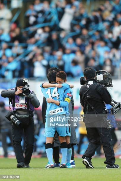 Kengo Nakamura and Yu Kobayashi of Kawasaki Frontale celebrate their 50 victory and the JLeaague Chmpions afetr the JLeague J1 match between Kawasaki...