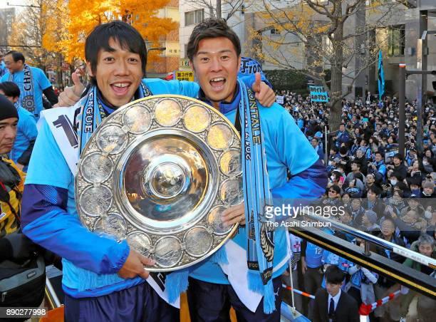 Kengo Nakamura and Yusuke Tasaka of Kawasaki Frontale celebarte during the Kawasaki Frontale Champions Parade on December 10 2017 in Kawasaki...