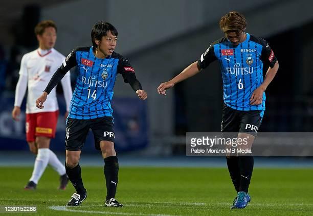 Kengo Nakamura congrats to Hidemasa Morita of Kawasaki during the J.League Meiji Yasuda J1 match between Kawasaki Frontale and Urawa Red Diamonds at...