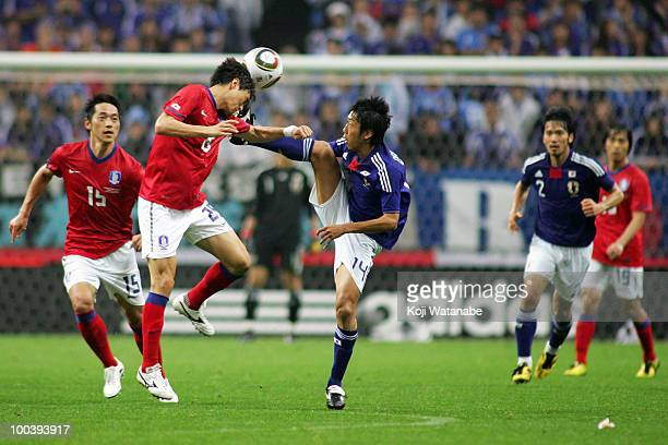 Kengo Nakamura of Japan and Lee Jung Soo of South Korea compete for the ball during the international friendly match between Japan and South Korea at...