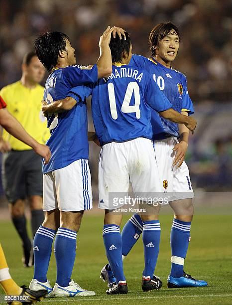 Kengo Nakamura of Japan celebrates after scoring with Shunsuke Nakamura during the Kirin Cup Soccer match between Japan and Belgium at the National...