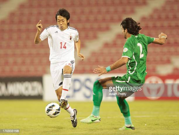 Kengo Nakamura of Japan controls the ball during the FIFA World Cup Asian qualifier match between Iraq and Japan at AlArabi Stadium on June 11 2013...