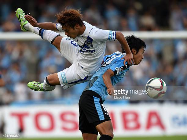 Kengo Nakamura of Kawasaki Frontale and Hiroyuki Abe of Gamba Osaka compete for the ball during the JLeague match between Kawasaki Frontale and Gamba...