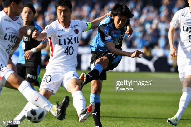 Kengo Nakamura of Kawasaki Frontale and Mitsuo Ogasawara of Kashima Antlers compete for the ball during the JLeague J1 match between Kawasaki...