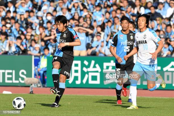 Kengo Nakamura of Kawasaki Frontale and Shunsuke Nakamura of Jubilo Iwata compete for the ball during the JLeague J1 match between Kawasaki Frontale...