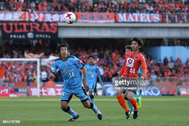 Kengo Nakamura of Kawasaki Frontale and Yusuke Segawa of Omiya Ardija compete for the ball during the JLeague J1 match between Kawasaki Frontale and...