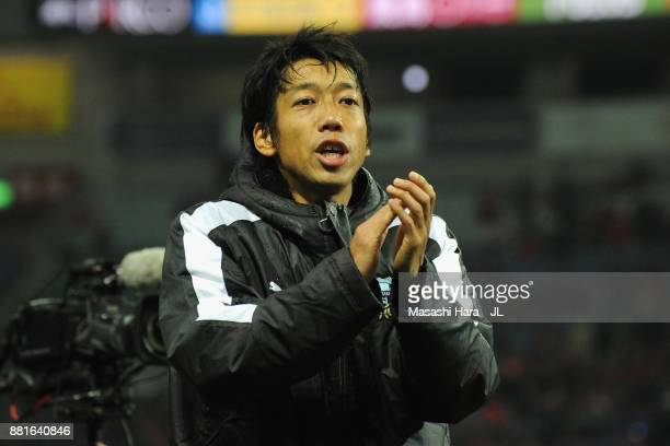 Kengo Nakamura of Kawasaki Frontale applauds supporters after his side's 10 Victory in the JLeague J1 match between Urawa Red Diamonds and Kawasaki...