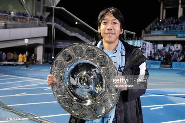 Kengo Nakamura of Kawasaki Frontale celebrate with the trophy after the J1 Champions after the J.League Meiji Yasuda J1 match between Kawasaki...