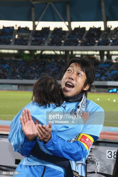 Kengo Nakamura of Kawasaki Frontale celebrates his team's JLeague Champions with his child after the JLeague J1 match between Kawasaki Frontale and...