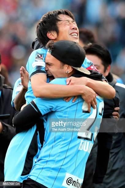 Kengo Nakamura of Kawasaki Frontale celebrates the J1 Champions with his team mate Eduardo after the JLeague J1 match between Kawasaki Frontale and...
