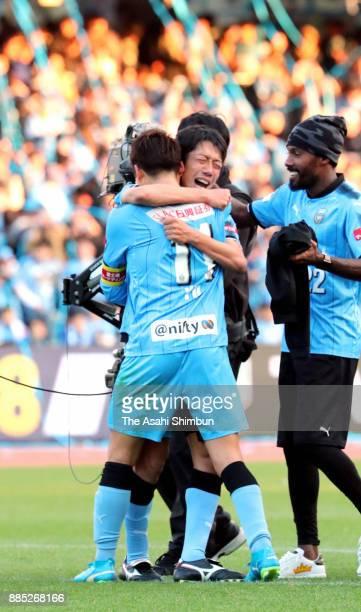 Kengo Nakamura of Kawasaki Frontale celebrates the J1 Champions with his team mate Yu Kobayashi after the JLeague J1 match between Kawasaki Frontale...