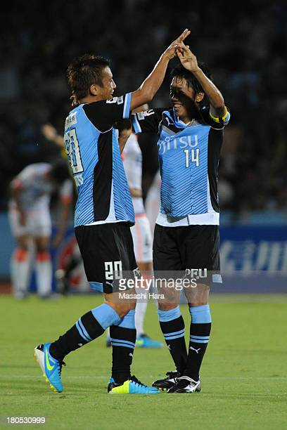 Kengo Nakamura of Kawasaki Frontale celebrates the second goal with Junichi Inamoto during the JLeague match between Kawasaki Frontale and Sanfrecce...