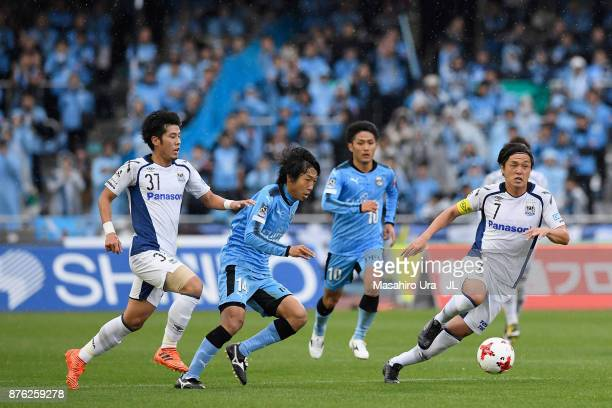 Kengo Nakamura of Kawasaki Frontale competes for the ball against Akito Takagi and Yasuhito Endo of Gamba Osaka during the JLeague J1 match between...
