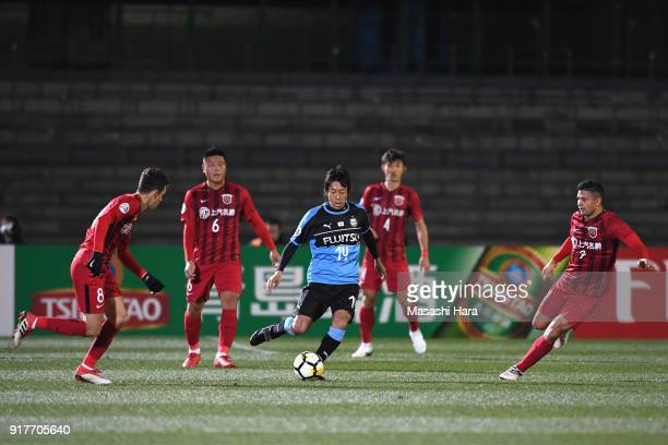 Kengo Nakamura of Kawasaki Frontale controls the ball under pressure Shanghai SIPG defense during the AFC Champions League Group F match between...