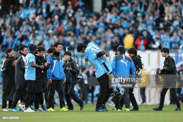 Kengo Nakamura of Kawasaki Frontale is congratulated by his team mate Eduardo of Kawasaki Frontale as they celebrate the JLeague Champions after the...