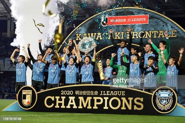 Kengo Nakamura of Kawasaki Frontale lifts the trophy as they celebrate the J1 Champions after the J.League Meiji Yasuda J1 match between Kawasaki...