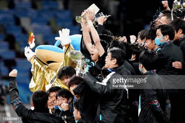 Kengo Nakamura of Kawasaki Frontale lifts the trophy as they celebrate the 100th Emperor's Cup after the 100th Emperor's Cup final between Kawasaki...