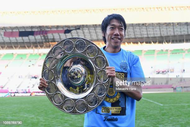 Kengo Nakamura of Kawasaki Frontale poses with the JLeague Champions Schale as he celebrates his side's J1 season champions after the JLeague J1...