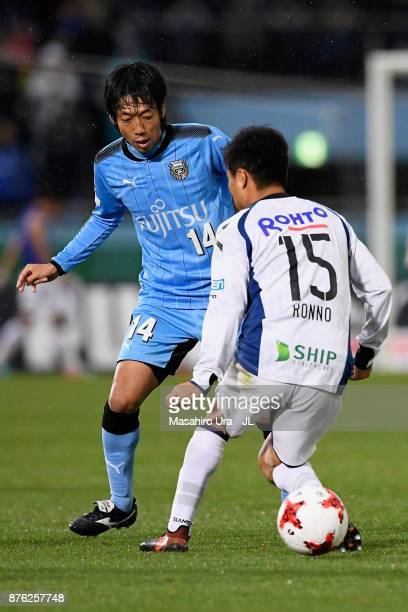 Kengo Nakamura of Kawasaki Frontale takes on Yasuyuki Konno of Gamba Osaka during the JLeague J1 match between Kawasaki Frontale and Gamba Osaka at...
