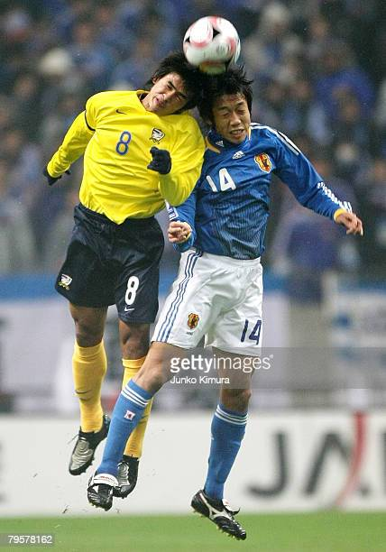 Kengo Nakmura of Japan and Suchao Nutnum of Thailand battle for the ball during the 2010 FIFA World Cup Asia 3rd preliminary round match between...