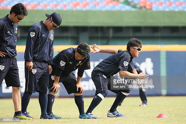 Kengo Takeda of Japan warms up prior to game of the IBAF 21U Baseball World Cup Group C game between Japan and South Korea at Taichung Baseball Field...