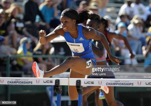 Keni Harrison clears a hurdle in the opening round of the Women's 100 Meter Hurdles during Day 2 of the 2017 USA Track Field Championships at Hornet...