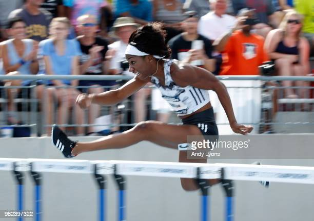 Keni Harrison clears a hurdle on her way to victory in the Womens 100 Meter Hurdles Final during day 3 of the 2018 USATF Outdoor Championships at...