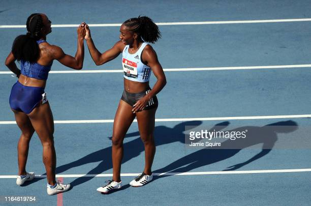Keni Harrison is congratulated by Brianna McNeal after winning the Women's 100 Meter Hurdle Final during the 2019 USATF Outdoor Championships at...