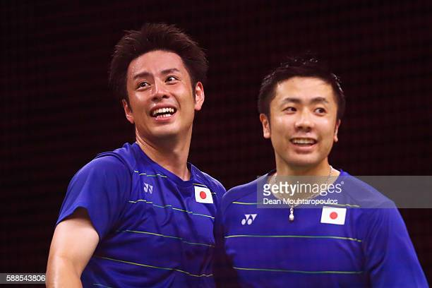 Kenichi Hayakawa and Hiroyuki Endo of Japan compete celebrate victory against Chai Biao and Hong Wei of China in the badminton Mens Doubles on Day 6...
