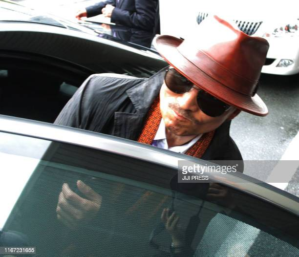 """Kenichi Shinoda, the boss of Japan's largest """"yakuza"""" gang, the Yamaguchi-gumi, gets into a car after arriving at the train station in Kobe, western..."""